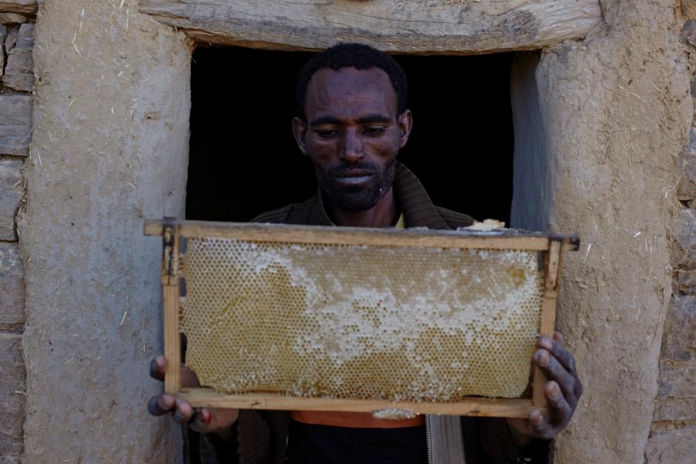 A proud member of the beekeeper's cooperative (Photo ©Robert Bellamy)